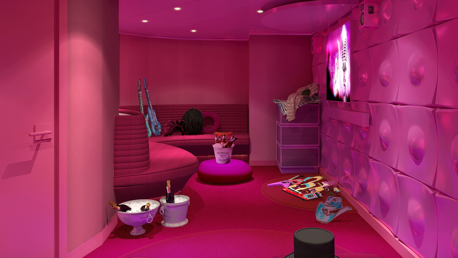 A private karaoke room with pink walls and floor