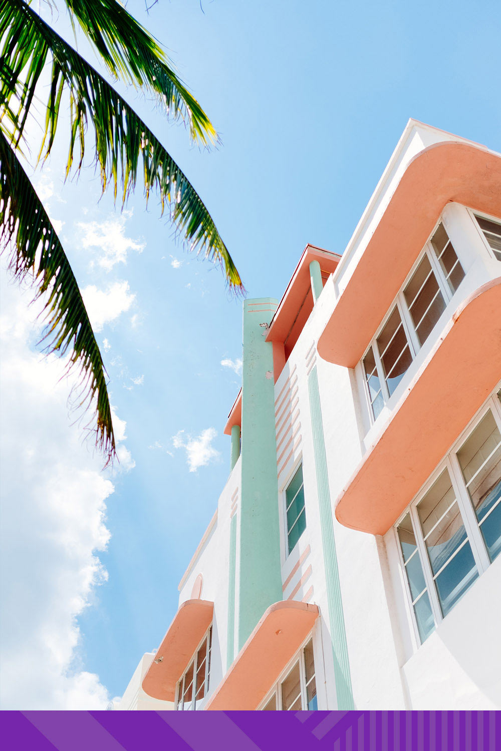 A shot of a building in Miami with an illustrated, color-block sky.