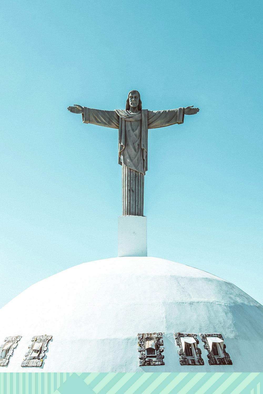 An image of Jesus atop a dome church